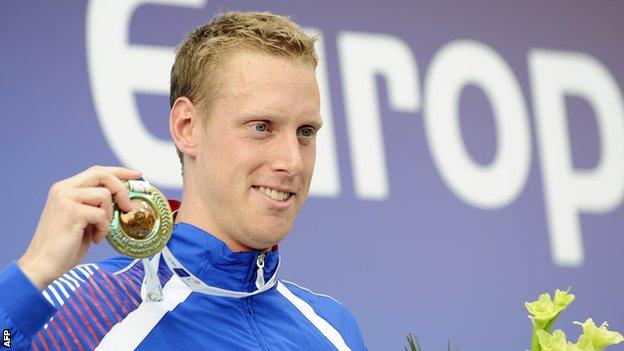 Joe Roebuck poses with his bronze medal for the 200m medley final at the European Swimming Championships in 2010