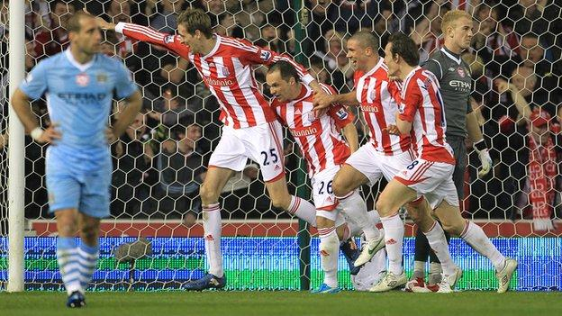 Peter Crouch celebrates his goal against Man City