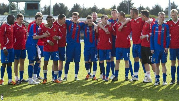The Inverness CT squad group together to acknowledge the home support after the last game of the SPL season