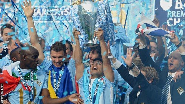 Sergio Aguero lifts the Premier League trophy