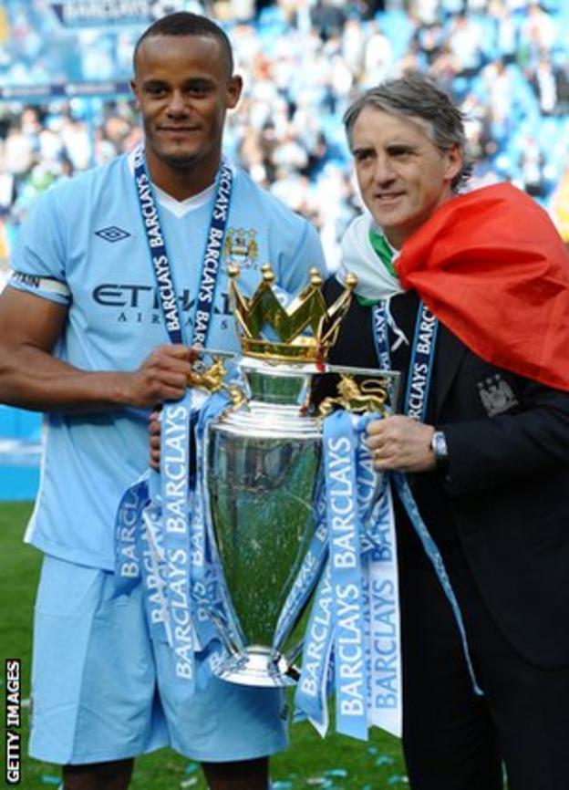 City skipper Vincent Kompany celebrates with manager Roberto Mancini