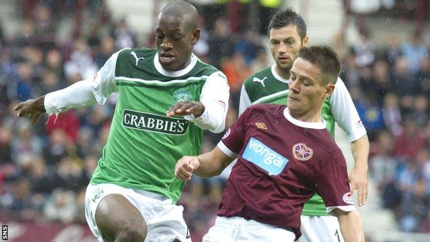 Ian Black competes for possession with Hibs' Isaiah Osbourne