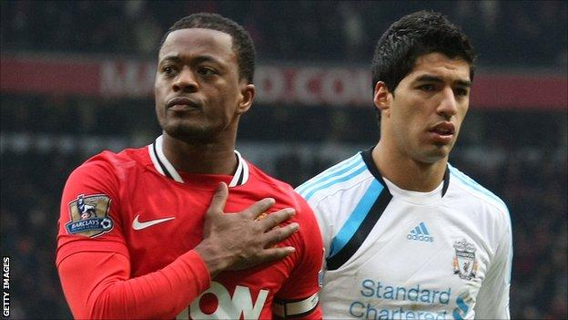 Manchester United's Patrice Evra (l) and Liverpool's Luis Suarez