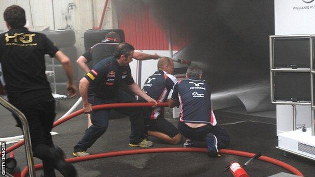 F1 crews fight the fire in the Williams garage