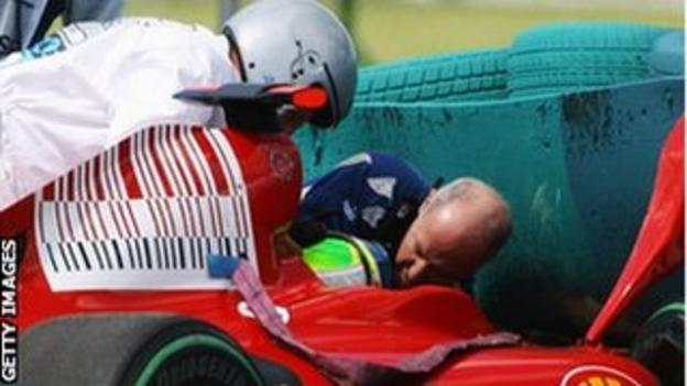 Felipe Massa of Brazil and Ferrari is attended to by Gary Hartstein, medical staff and marshalls following his accident during qualifying for the 2009 Hungarian Grand Prix