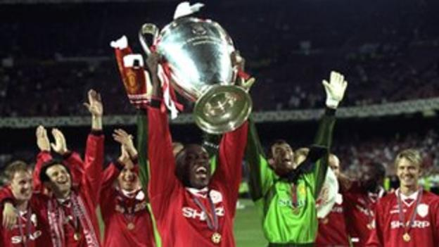 Dwight Yorke lifts the European Champions League in 1999