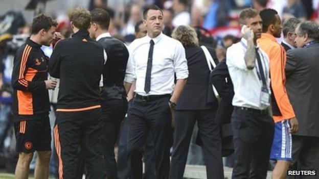 Chelsea's captain John Terry (centre) stands by the pitch before the start of the Champions League final