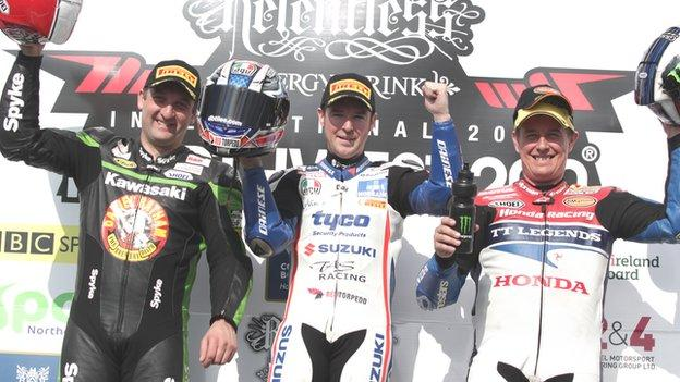Michael Rutter, Alastair Seeley and John McGuinness on the podium after the second Superbike race