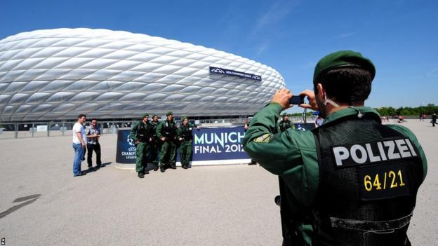 Policeman takes a photograph