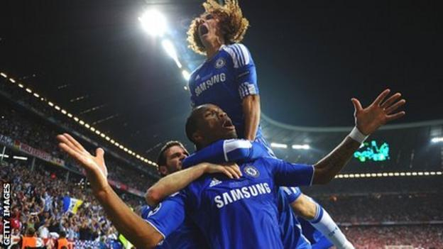 Didier Drogba and team-mates celebrate the Ivorian's equaliser