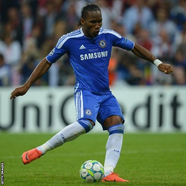 Didier Drogba scores the final penalty