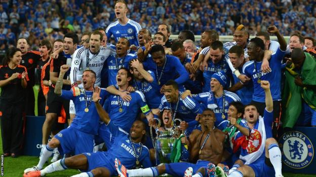 Chelsea players celebrate with trophy