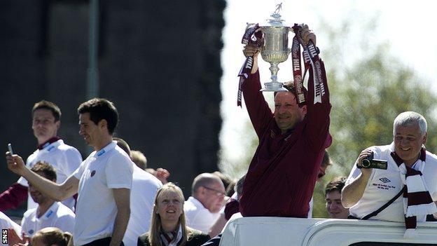 Sergio holds the Scottish Cup aloft as Hearts parade through Edinburgh