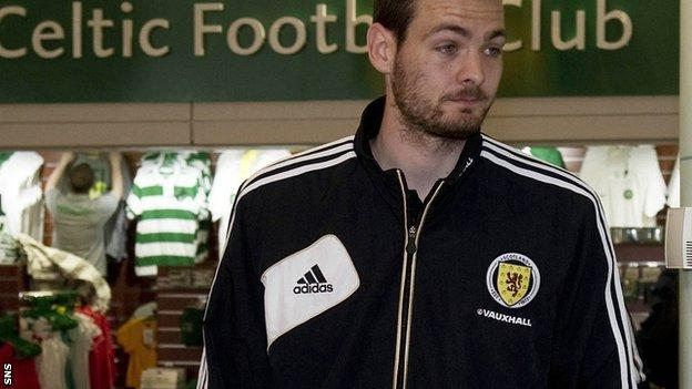 Gordon, who has been linked with Celtic, leaves Glasgow Airport with the Scotland squad