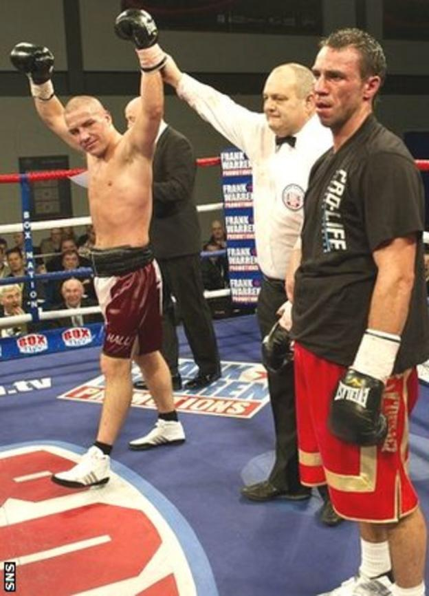 Matthew Hall's arm is raised for a points win over Kris Carslaw in November 2011