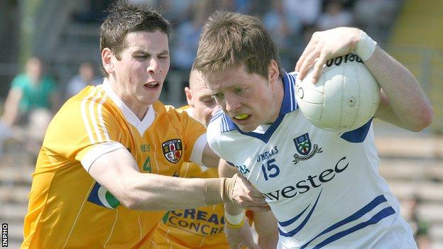 Antrim's Kevin O'Boyle challenges Monaghan's Conor McManus
