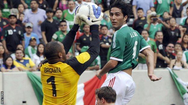 Wales goalkeeper Jason Brown saves a hader from Mexico goalscorer Aldo de Nigris