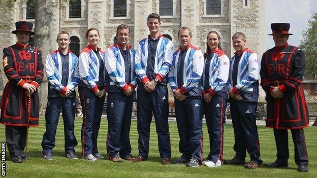 James Huckle, Jennifer McIntosh, Richard Faulds, Peter Wilson, Richard Brickell, Georgina Geikie and Rory Warlow pose at the Tower of London