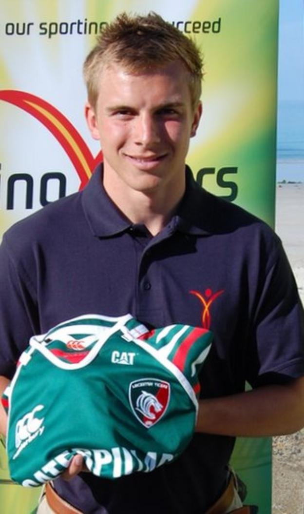 Luke Jones with a Leicester Tigers shirt