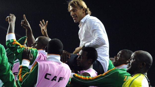 Zambia coach Herve Renard is hoisted aloft after winning the 2012 Africa Cup of Nations