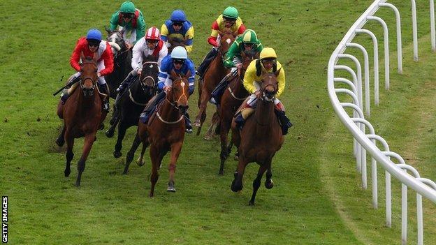 Riders rounding Tattenham Corner in the Derby