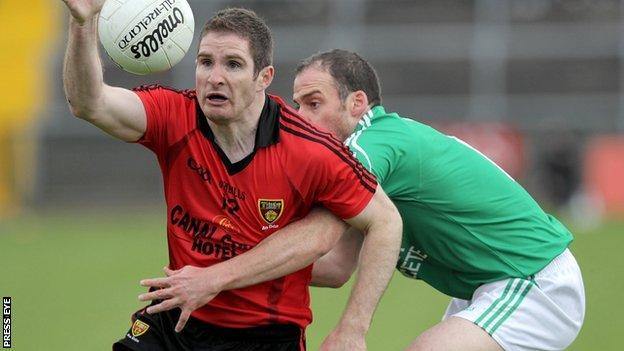 Down's Aidan Carr in possession against Brian Og Maguire of Fermanagh