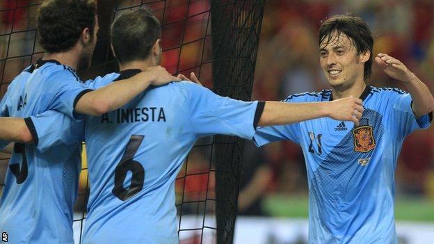 Spain's David Silva celebrates with his team-mates