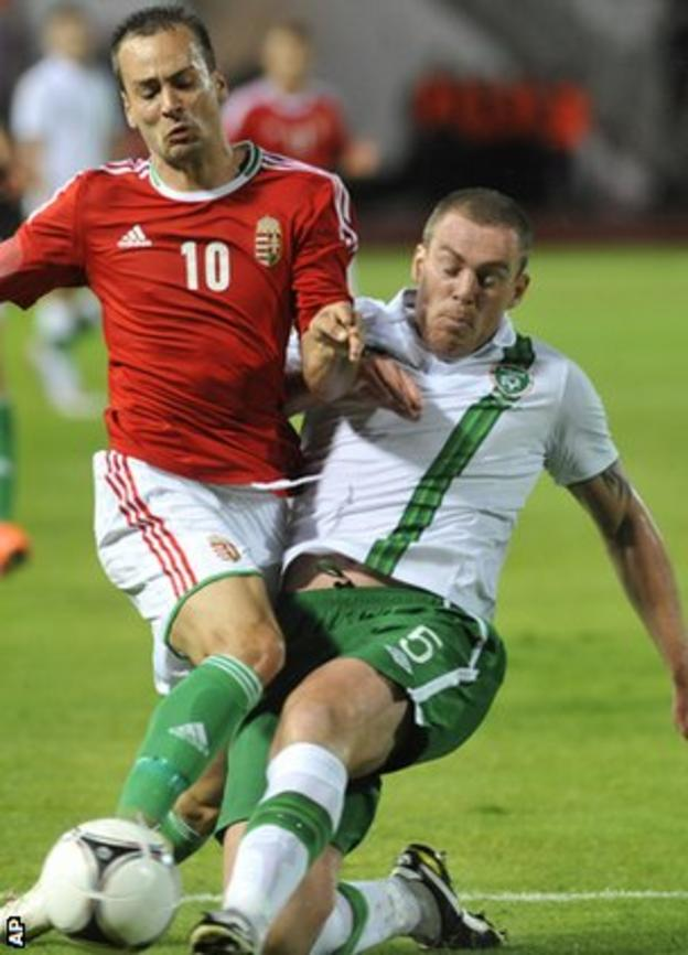 Hungary's Peter Szakaly is tackled by Republic of Ireland defender Richard Dunne