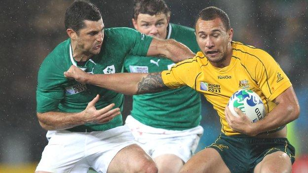 Rob Kearney tackles Quade Cooper in the World Cup win over Australia