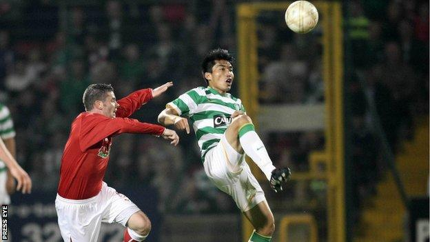 Chris Scannell battles with Celtic's Zhi Zheng in the 2009 friendly at Solitude