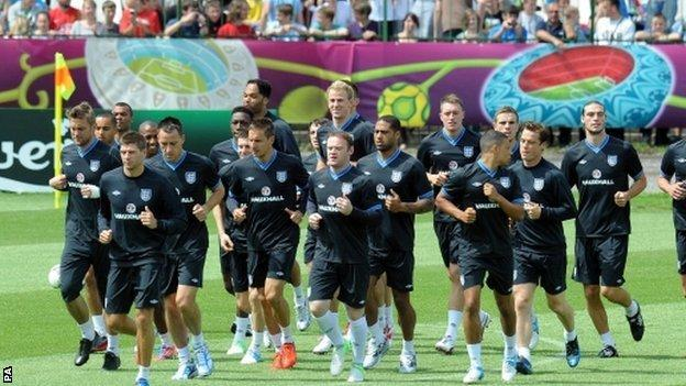 Ashley Cole (third from left) trains with England in Krakow