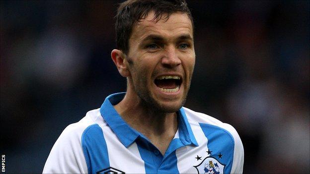 Fleetwood Town midfielder Damien Johnson