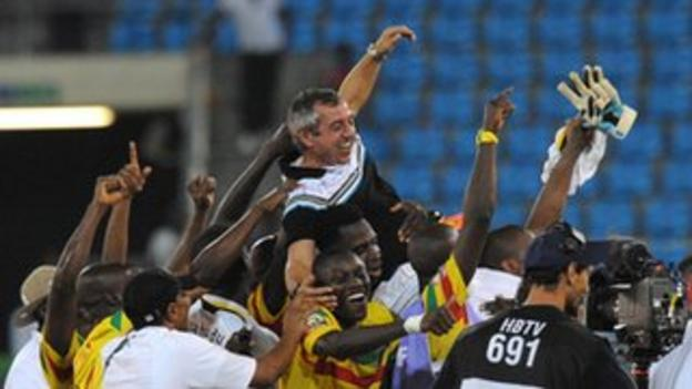 Mali's team celebrate third place at the Nations Cup with coach Alain Giresse