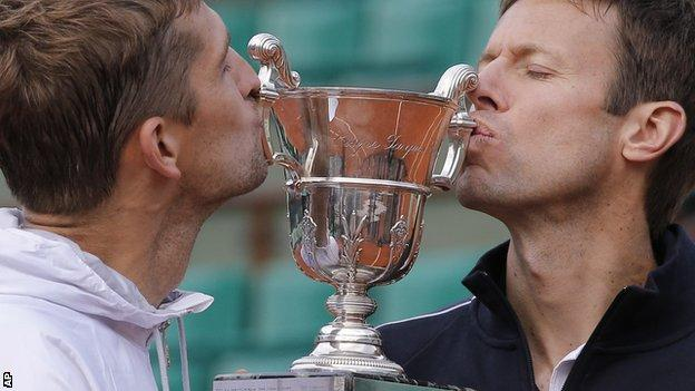 Max Mirnyi, left, and Daniel Nestor kiss the trophy after winning the men's doubles final against Bob and Mike Bryan at the French Open