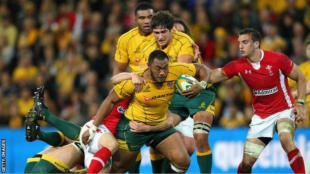 Australia prop Sekope Kepu carries the ball against Wales