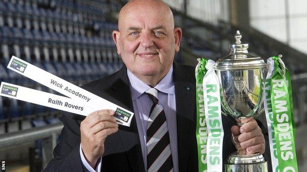 Wick first team coach Robert Mulheron helps to conduct the Ramsdens Cup first round draw