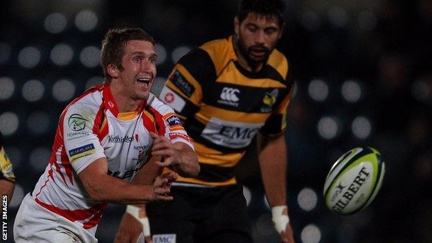 Dragons scrum-half playing against Wasps