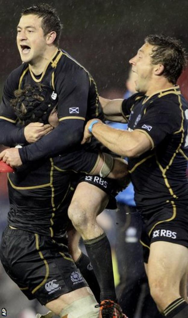 Cusiter (right) celebrates after Scotland open their tour with a win over Australia