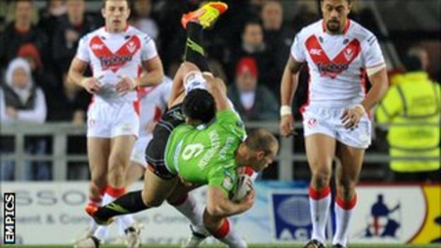 Jonny Lomax tackles Daniel Holdsworth during St Helens' win against Salford in February