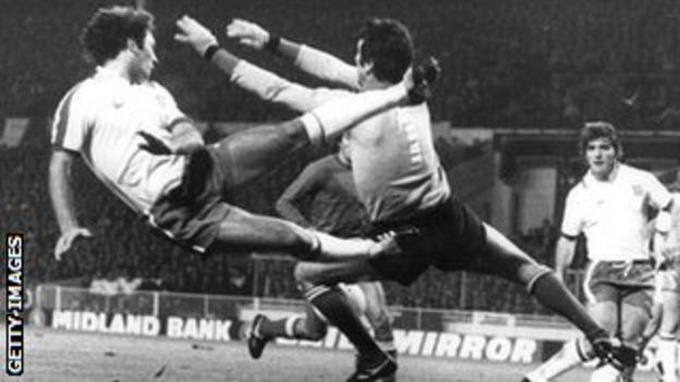 Ray Wilkins (left) clashes with Italian goalkeeper Dino Zoff at Wembley