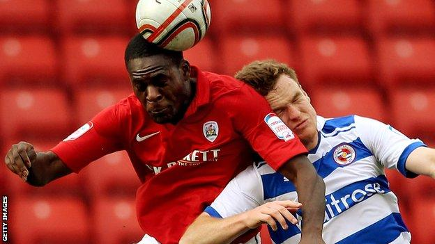 Frank Nouble (left) heads the ball during a loan spell at Barnsley