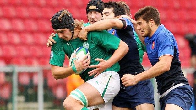 Ireland's Iain Henderson is tackled in the fifth/sixth place play-off