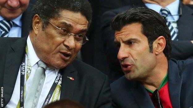 Eusebio (left) with Luis Figo