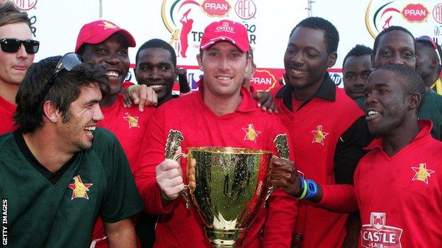 Zimbabwe celebrate with the series trophy