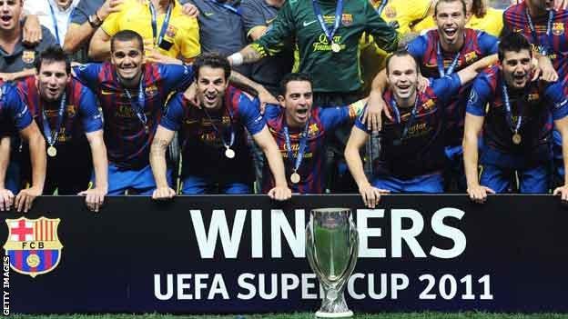Barcelona celebrate their 2011 Super Cup win