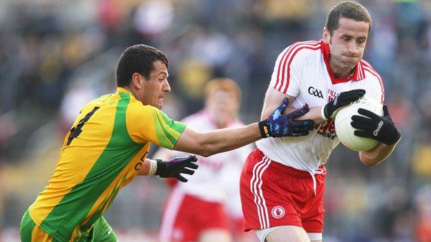 Donegal's Frank McGlynn in action against Stephen O'Neill of Tyrone