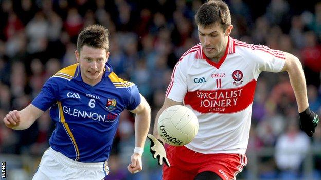 Longford's Michael Quinn in action against Mark Lynch of Derry