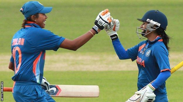 Jhulan Goswami and Mithali Raj celebrate India's win