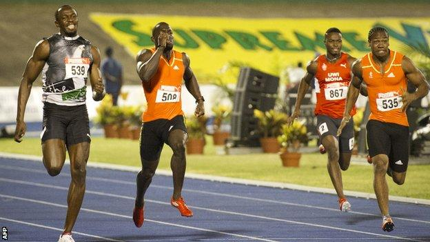 Usain Bolt and Yohan Blake run for the line in the 200m