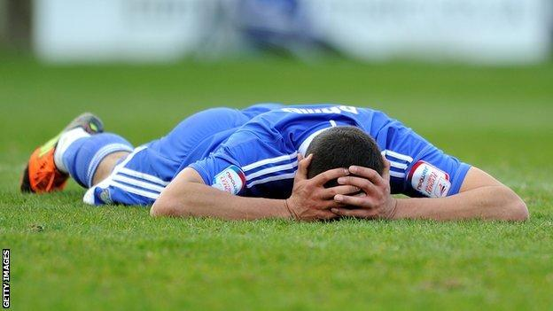 Colin Daniel is dejected after Macclesfield are relegated from the Football League